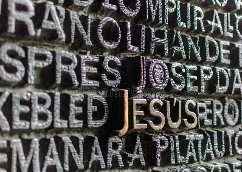 Detail of the bronze door of Passion facade of Sagrada Familia. Detail with word Jesus on the bronze door of Passion facade of Sagrada Familia in Barcelona. The stock photos