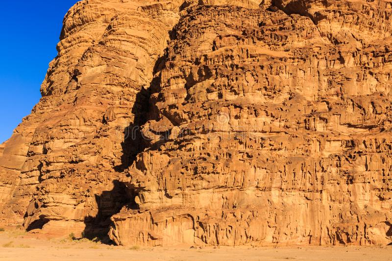 Detail of the yellow colored mountain rocks in the Wadi rum desert in Jordan at early-morning royalty free stock photo