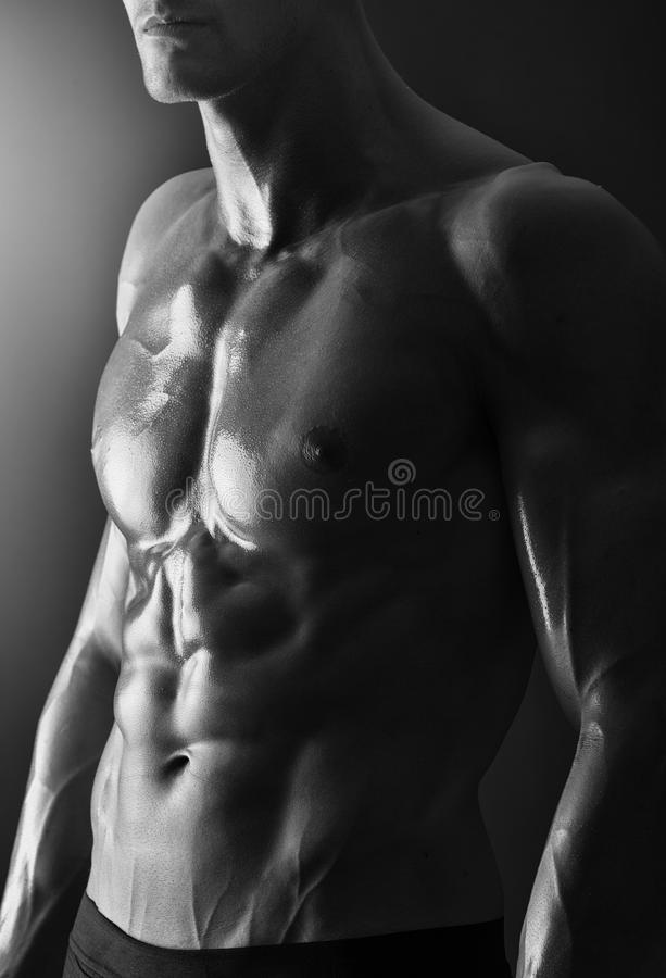 Detail of a young shirtless muscular man royalty free stock photography