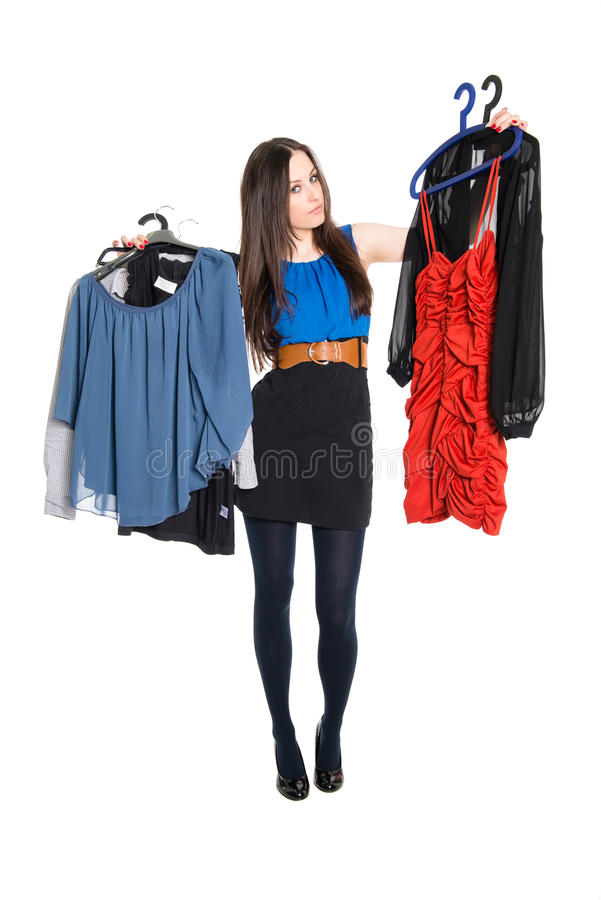 Download Attractive Brunette Choosing Which Dress To Wear Stock Photo - Image: 30037714