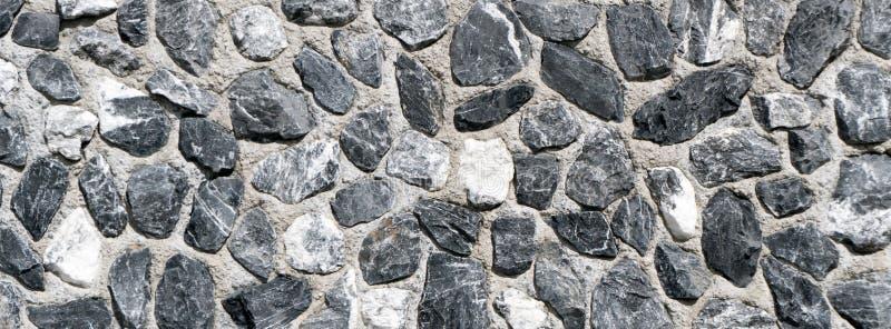 Detailachtergrond van de achtergrond van de het graniettextuur van de rotsmuur royalty-vrije stock fotografie