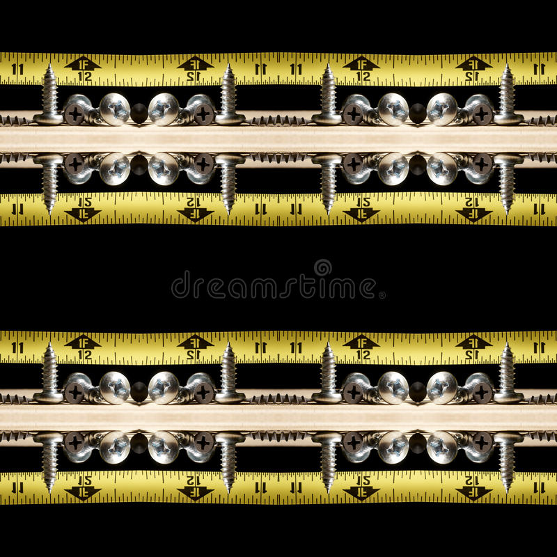 Home Improvement Tools, Screws and Tape Measure on Wood royalty free stock images