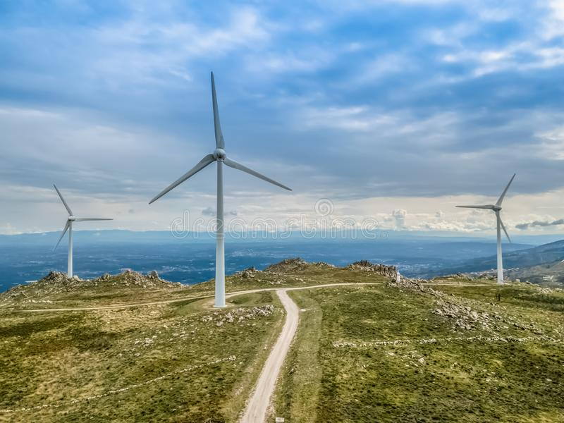 Detailed aerial view, by drone, of a wind turbines on top of mountains royalty free stock photos