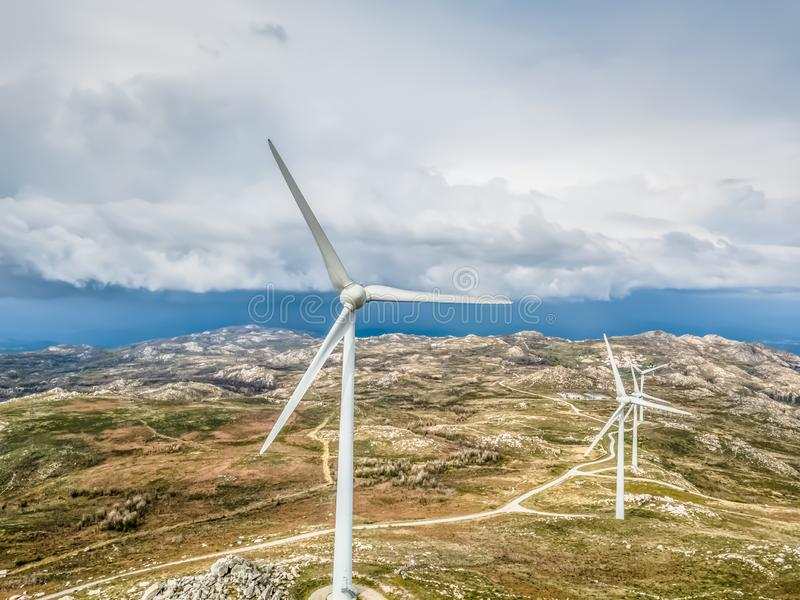 Detailed aerial view, by drone, of a wind turbines on top of mountains royalty free stock images