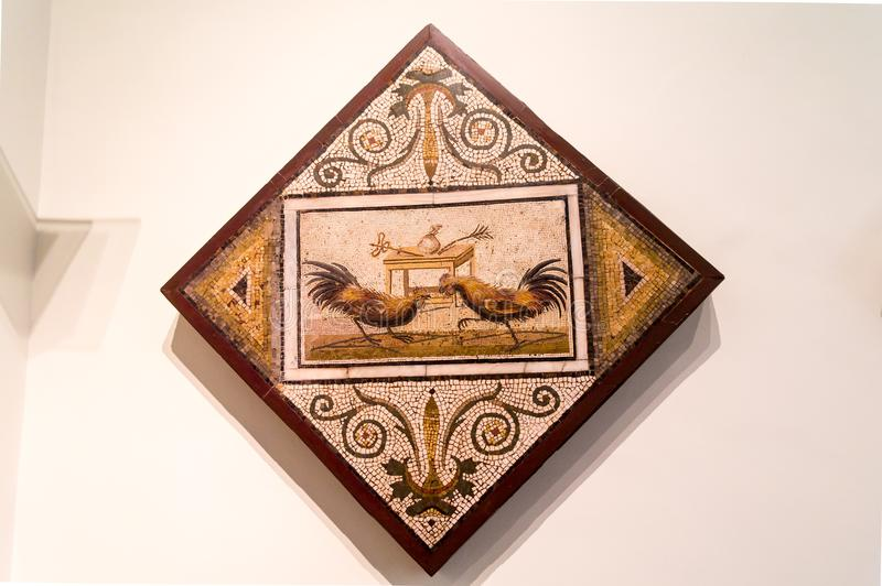 Detailed ancient mosaic from Pompeii, showing a cockfight stock photography
