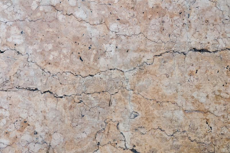 Detailed beige cracked stone surface royalty free stock images