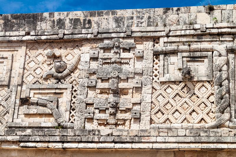 Detailed carvings at the Nun`s Quadrangle Cuadrangulo de las Monjas building complex at the ruins of the ancient Mayan. City Uxmal, Mexico royalty free stock photo