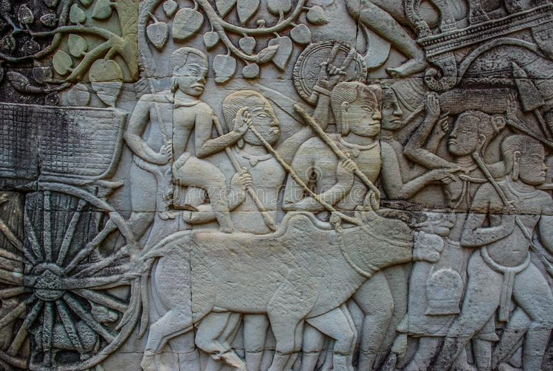 Detailed carvings of warriors and an Ox Cart on Walls of Angkor Wat stock photos