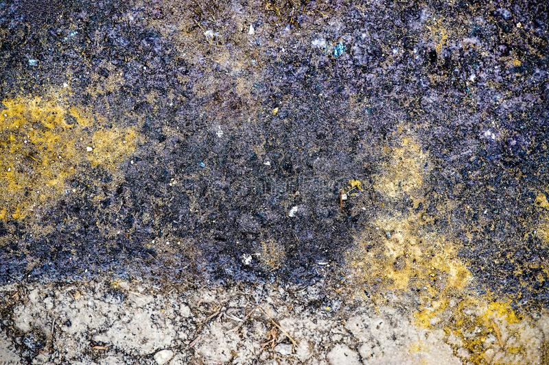 Detailed close up view on aged and cracked asphalt on roads in northern europe royalty free stock photo