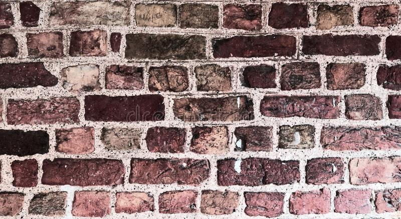 Detailed close up view on old and weathered red brick walls in high resolution stock image