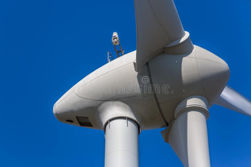 Detailed close up view of a wind turbine. Generator, rotor and blade view, white, background, environment, electricity, mill, technology, environmental stock photos