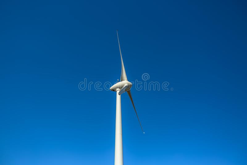 Detailed close up view of a wind turbine. Generator, rotor and blade view, white, background, environment, electricity, mill, technology, environmental stock photo