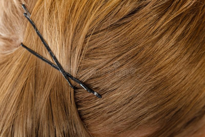 Detailed closeup of brown hair with clips. Detailed close up of brown, dark blonde hair in ponytail with clips. Hairdo surface royalty free stock photography