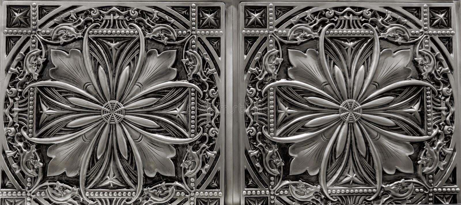 Detailed closeup view of dark silver, metallic, interior ceiling decoration tiles royalty free stock photos