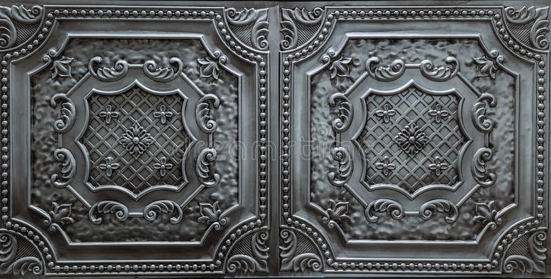 Detailed closeup view of dark silver, metallic, interior ceiling decoration tiles. Fabulous amazing, detailed closeup view of dark silver, metallic, interior royalty free stock images