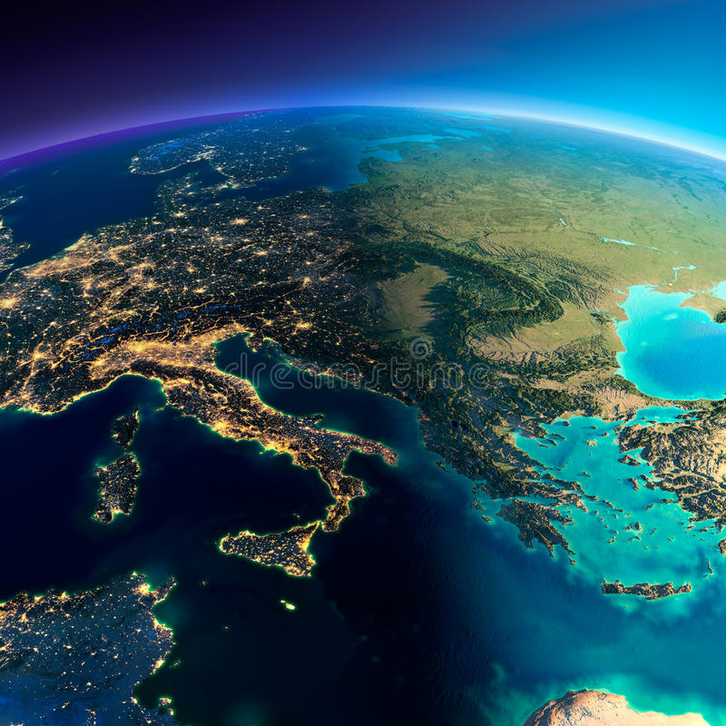 Detailed Earth. Italy, Greece and the Mediterranean Sea. Highly detailed planet Earth. Night with glowing lights of the city gives way to day. The boundary of stock illustration