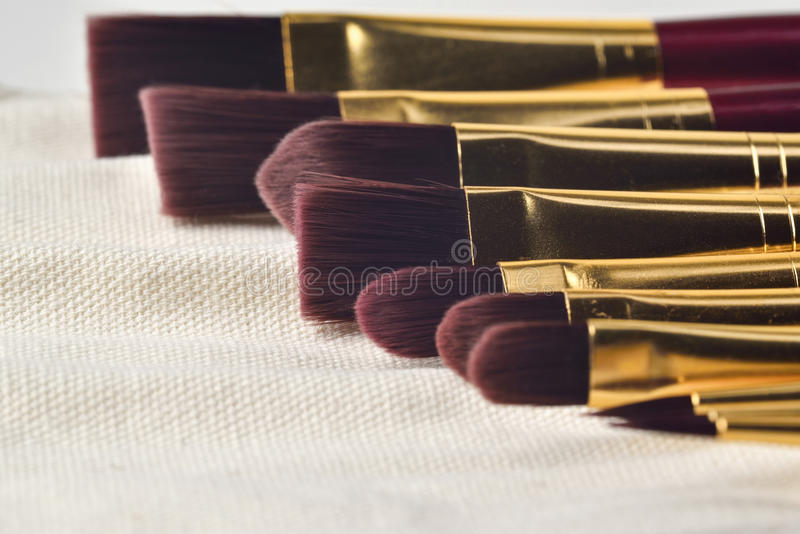 Detailed fine Art painting brushes. In transport bag stock photos