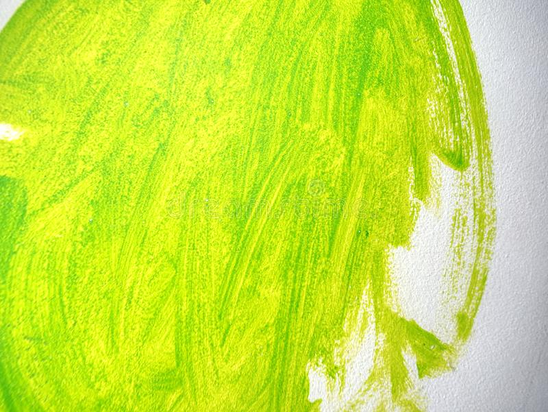 Detailed green long brush strokes on sandy stucco. Decorative plaster. On the wall in children bedroom with funny colors royalty free stock photography