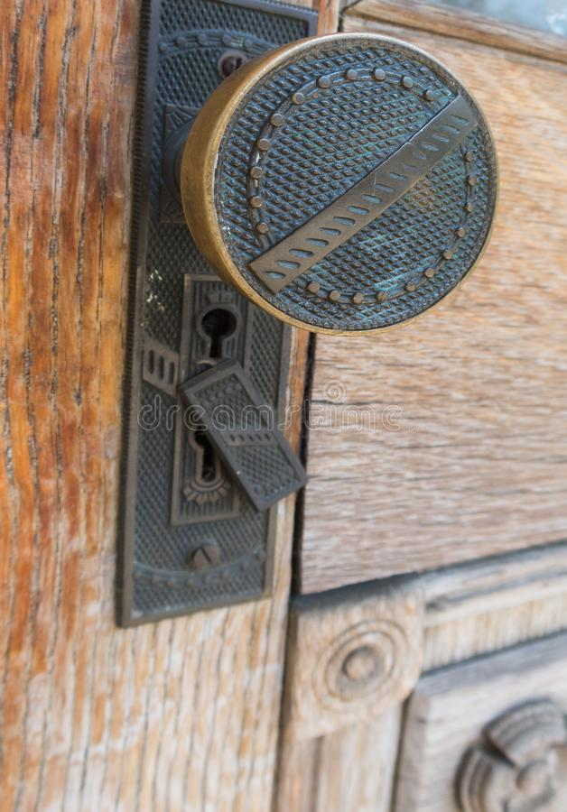 Detailed knob on an old door royalty free stock photography