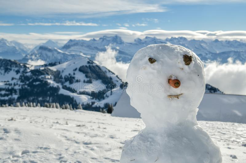 Detailed look at snowman`s face on top of Mount Rigi stock image