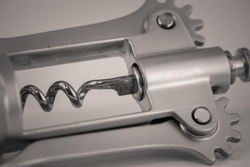 Detailed monocrome macro shot of a metal corkscrew. Kitchen royalty free stock images