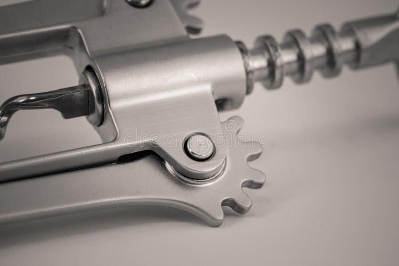 Detailed monocrome macro shot of a metal corkscrew. Kitchen royalty free stock image