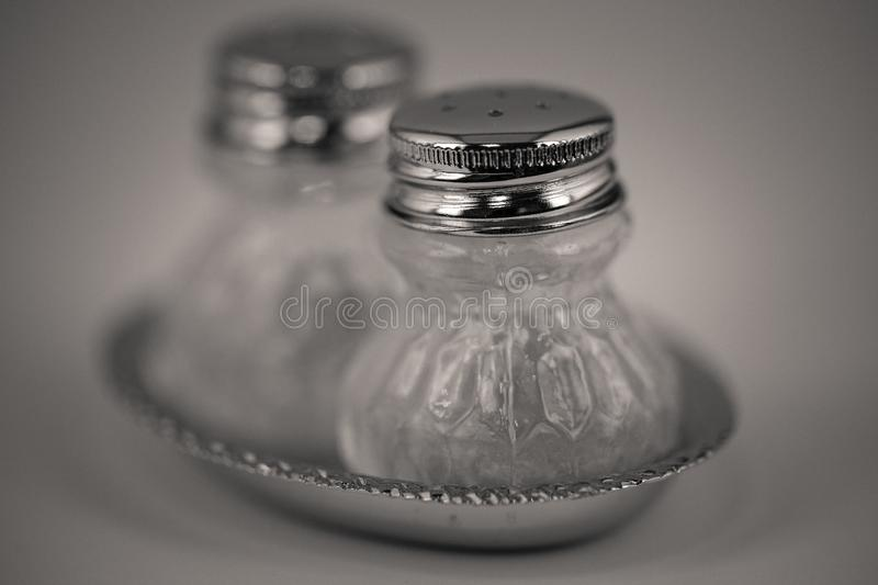 Detailed monocrome macro shot of a salt and pepper shaker. Kitchen royalty free stock photos