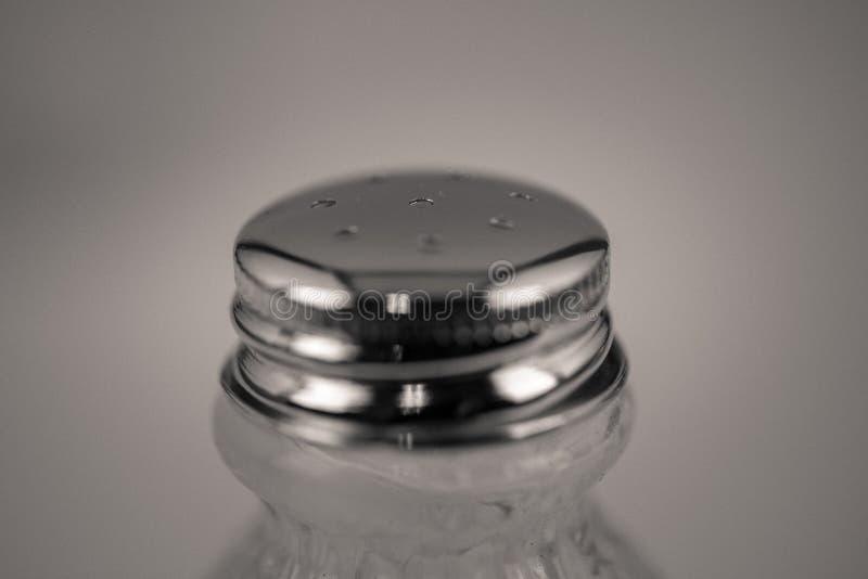 Detailed monocrome macro shot of a salt shaker. Kitchen royalty free stock photo