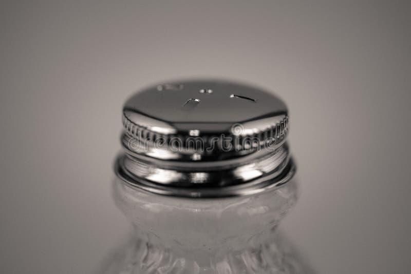 Detailed monocrome macro shot of a salt shaker. Kitchen stock image
