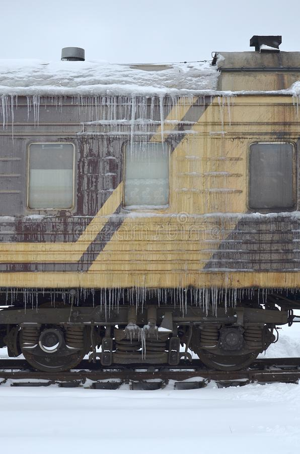 Free Detailed Photo Of A Frozen Car Passenger Train With Icicles And Ice On Its Surface. Railway In The Cold Winter Seaso Stock Photography - 116536122