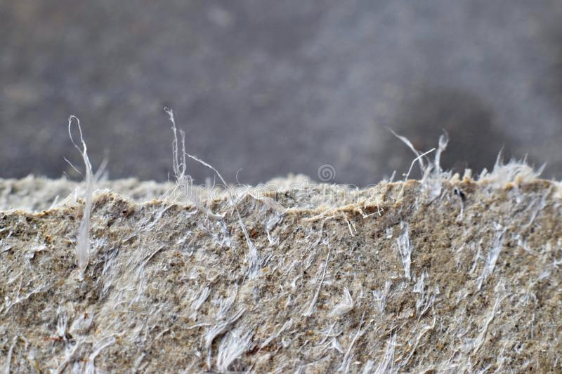 Detailed photography of roof covering material with asbestos fibres. Health harmful and hazards effects. Prolonged inhalation of microscopical fibers causes stock photo