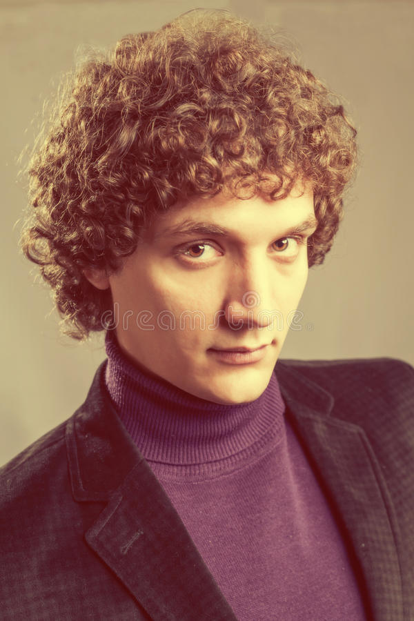 Detailed portrait of a young caucasian guy with stock photos