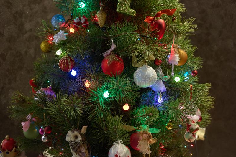 Detailed shot of decorated Christmas tree. Close up Christmas tree with beautiful stylish ornaments indoors. Christmas time background stock image