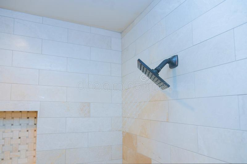 Detailed of a shower head with shower spray the jets of water royalty free stock photo