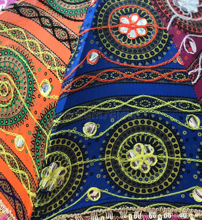 Embroidery on colorful Fabric on East African Umbrella stock photos
