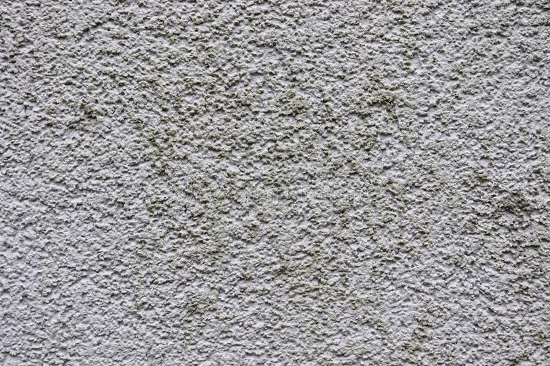 Detailed view of aged concrete walls with cracks and a lot of structure in high resolution royalty free stock image