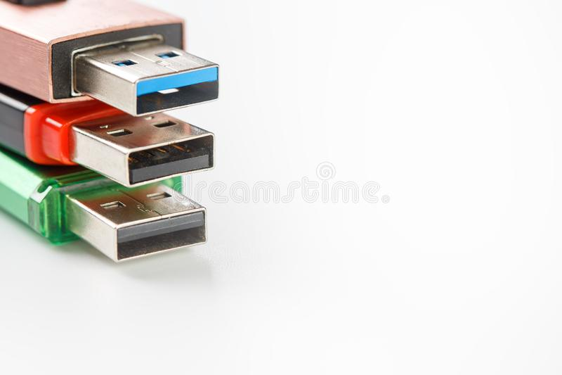 Detailed view of a black USB flash drive with a silver-blue connector. Photo on a white background stock image