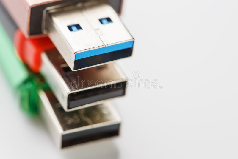 Detailed view of a black USB flash drive with a silver-blue connector. Photo on a white background royalty free stock images