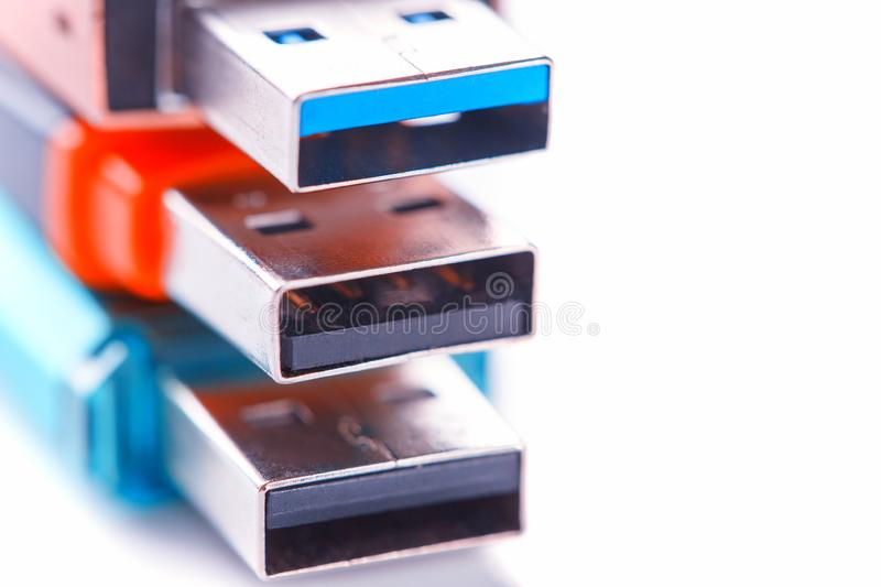 Detailed view of a black USB flash drive with a silver-blue connector. Photo on a white background royalty free stock image