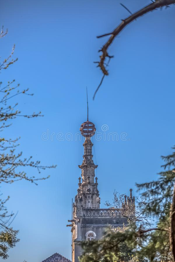 Detailed view of Buçaco palace tower in the middle of trees royalty free stock images