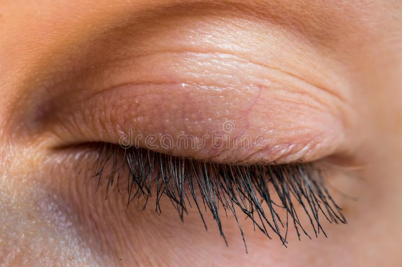 Detailed view of closed eye of woman stock photo