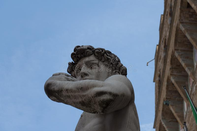 Detailed view of the copy of statue David by Michelangelo in front of the Palazzo Vecchio, Florence, Italy royalty free stock photos