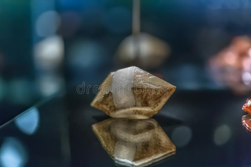 Detailed view of a mineral stone on blurred background. Colored, details, museum, macro, small, gemstone, natural, specimen, texture, rock, sample stock photography
