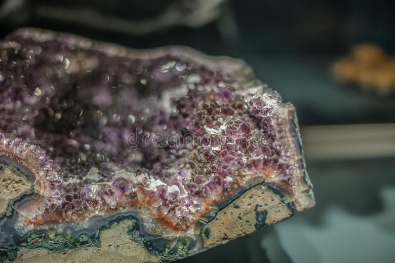 Detailed view of a mineral stone on blurred background. Colored details museum macro small gemstone natural specimen texture rock sample semiprecious surface royalty free stock photo