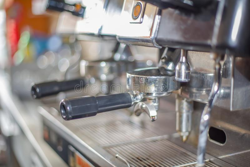 Detailed view of a professional Italian espresso machine with detail of ground coffee handles royalty free stock images