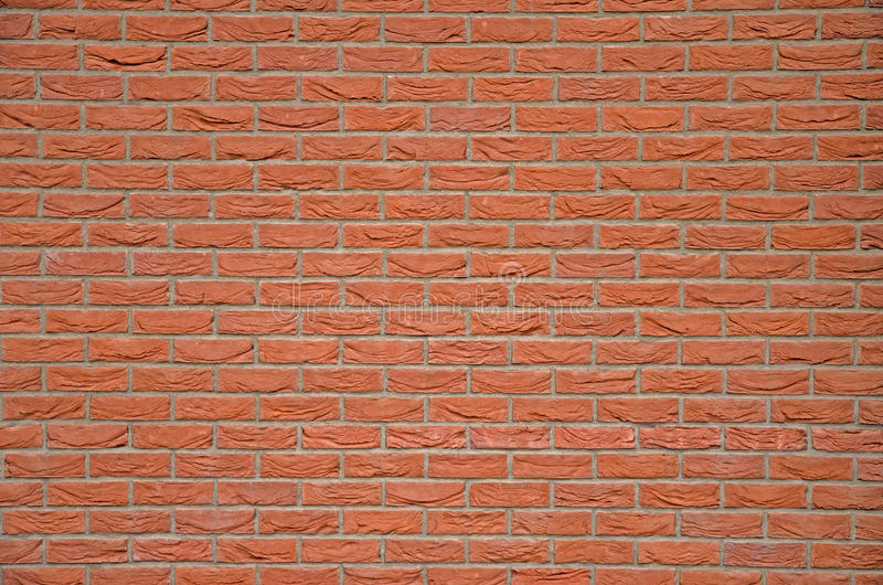 A detailed view of the structure of a wall of red brick stock photo