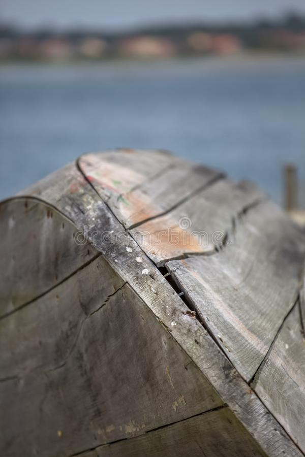Detailed view of a textured rusty and antique traditional fishing boat, on beach in lagoon on Costa Nova stock photography