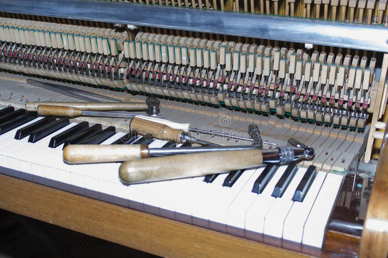 Detailed view of Upright Piano during a tuning.  stock photos