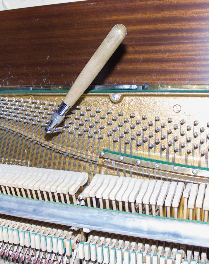 Detailed view of Upright Piano during a tuning.  stock photography