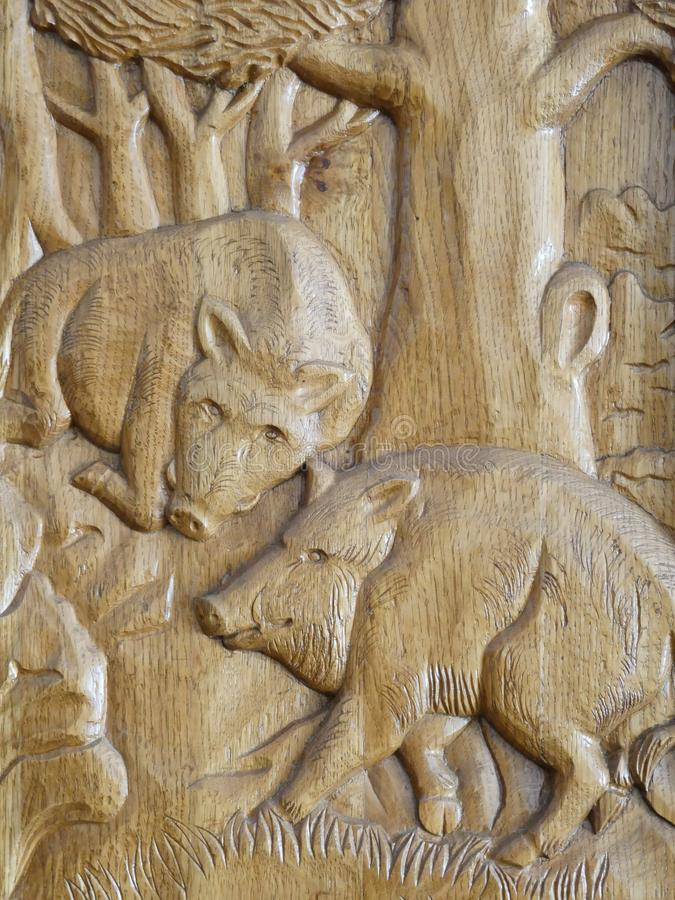 Detailed wild boars wooden sculpture stock images